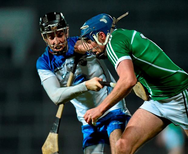 Limerick's Gavin O'Mahony fights for possession with Waterford's Paudie Prendergast Photo: Matt Browne / Sportsfile