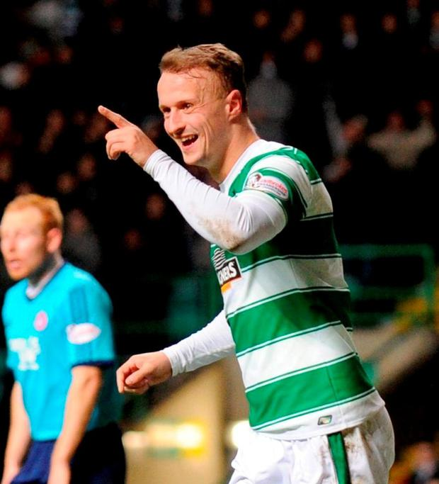 Celtic's Leigh Griffiths celebrates scoring their fifth goal of the game.