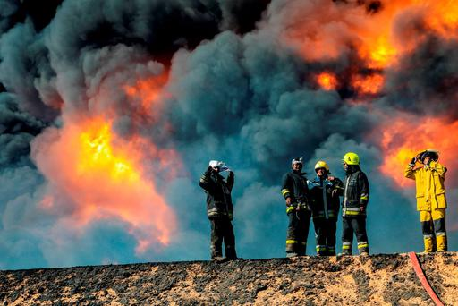 Firefighters try to put out the fire in an oil tank in the port of Es Sider, in Ras Lanuf, Libya, in this file picture taken January 6, 2016. The attacks against Libya's biggest oil terminals were lethal and sustained. The last two weeks have seen suicide bombings, huge fires at storage tanks, and a hole blown in a major pipeline. The oil ports of Es Sider and Ras Lanuf had been closed for more than a year, and the Islamic State militants advancing on them backed off after three days of shelling and clashes (Reuters)