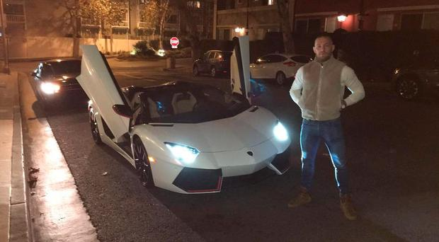 Conor McGregor poses beside his new investment. Credit: Conor McGregor/Instagram