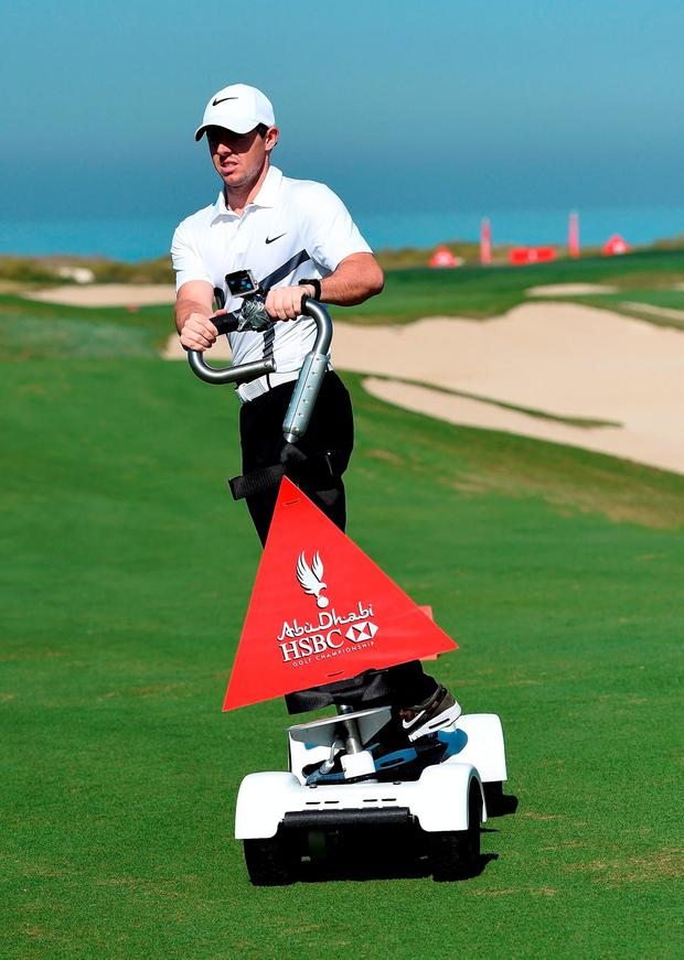 Rory McIlroy pictured riding a Golfboard in 'The Rider Cup Desert Challenge' at Saadiyat Beach Golf Club