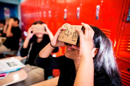Students using virtual reality goggles in the Google expeditions project which allows people to take a virtual tour of Buckingham Palace in London Credit: Andrew Federman/Google/PA Wire