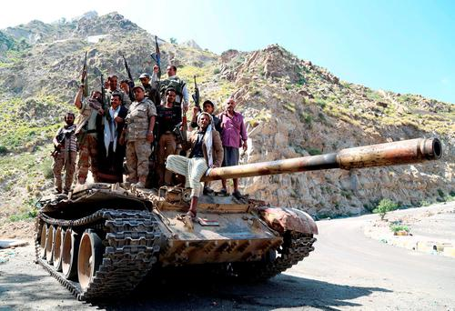 Fighters of the pro-government Popular Resistance militia stand atop a tank near Yemen's southwestern city of Taiz. Reuters /Stringer