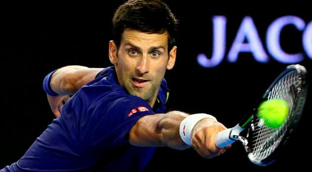 Novak Djokovic of Serbia stretches for a backhand in his second round match against Quentin Halys of France today