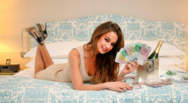 Top model Thalia Heffernan celebrates a recent Euromillions draw