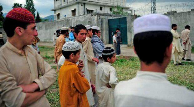 Pakistani seminary students gathering in front of the final hiding place of Osama bin Laden, in Abbottabad, in 2011