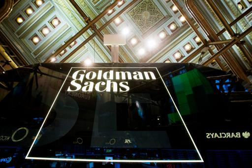 A Goldman Sachs sign is seen above the floor of the New York Stock Exchange. Photo: Reuters