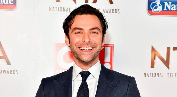 Aidan Turner with the award for Best Drama Performance (Poldark) pictured backstage at the Nation Television Awards 2016, at the O2 Arena, London. PRESS ASSOCIATION Photo. Picture date: Wednesday January 20, 2016