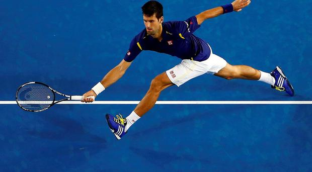 Serbia's Novak Djokovic stretches to hit a shot during his second round match against France's Quentin Halys at the Australian Open tennis tournament at Melbourne Park, Australia yesterday (Reuters)