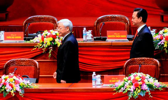 Vietnam Communist Party Secretary General Nguyen Phu Trong (left) and Prime Minister Nguyen Tan Dung walk on the podium during the official opening ceremony of the Vietnam Communist Party's 12th National Congress being held in Hanoi. Reuters/Hoang Dinh Nam/Pool