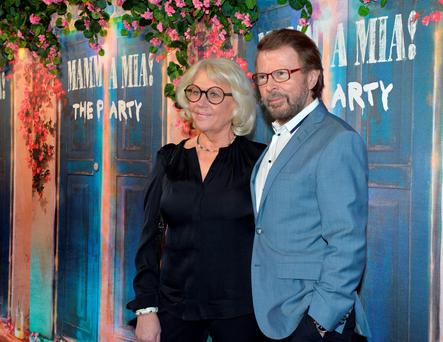 Former Abba member Bjorn Ulvaeus and his wife Lena Kallersjo arrive for the premiere of