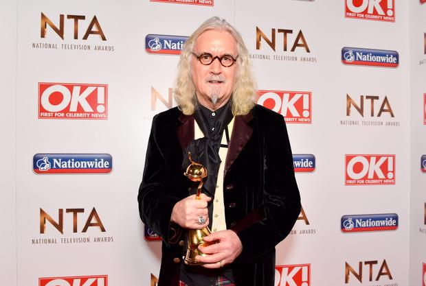 Billy Connolly with the Special Recognition Award pictured backstage at the Nation Television Awards 2016. Photo: Matt Crossick/PA Wire.