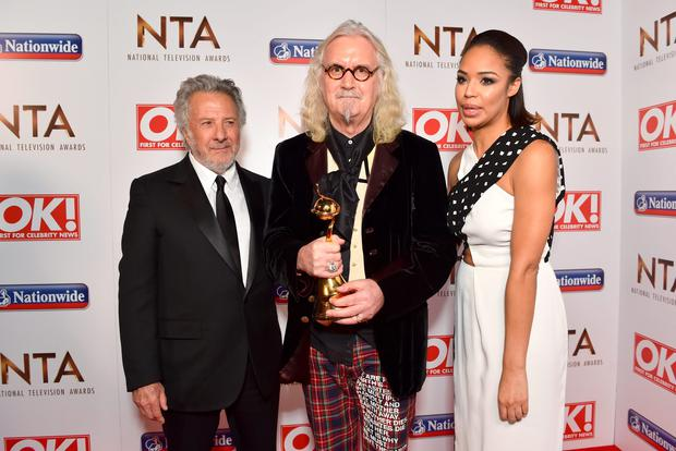Sarah Jane Crawford with Dustin Hoffman presenting Billy Connolly with the Special Recognition Award. Photo: Matt Crossick/PA Wire.