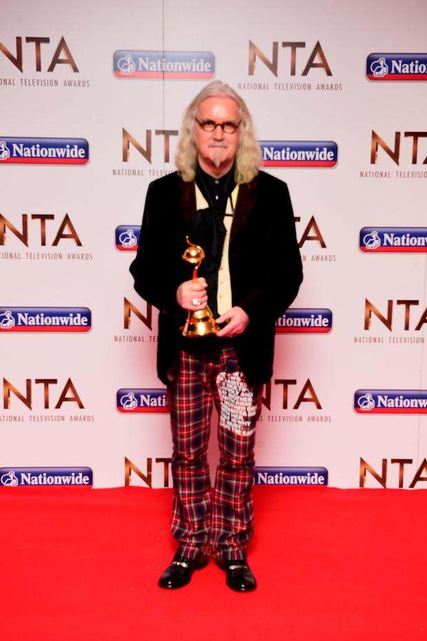 Billy Connolly with the Special Recognition Award in the press room at the National Television Awards 2016 held at The O2 Arena in London. Photo: Ian West/PA Wire