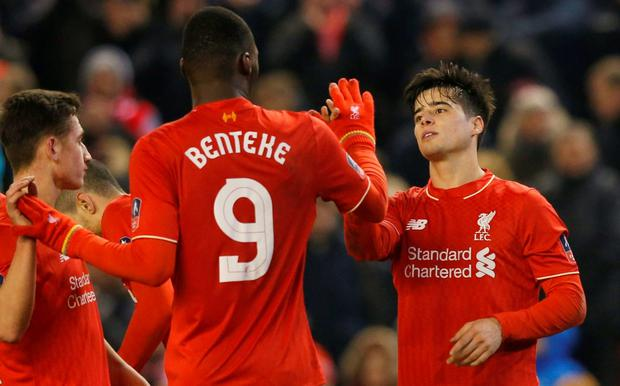 Liverpool's Joao Carlos Teixeira celebrates scoring their third goal with Christian Benteke