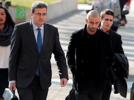 Barcelona's Argentinian defender Javier Mascherano (2nd R) arrives at the courthouse on January 21, 2016 in Barcelona.