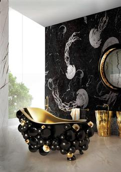 Touched Interiors' gold plated bubbles bathtub.