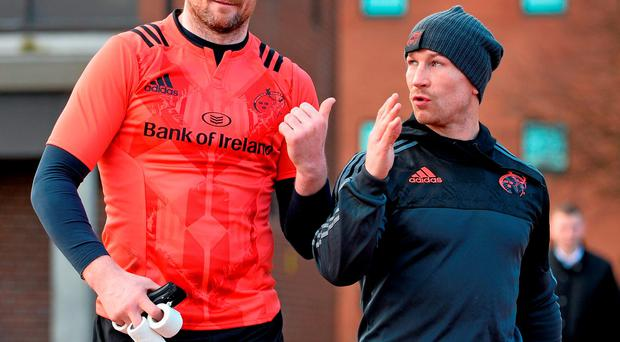 Donnacha Ryan and scrum coach Jerry Flannery deep in conversation as they make their way out for training Photo: Sportsfile
