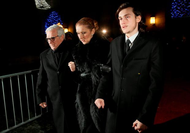 Celine Dion (C) and Rene Charles Angelil (R) leave after attending a Public Memorial Service for Celine Dion's Husband Rene Angelil at Notre-Dame Basilica on January 21, 2016 in Montreal, Canada. (Photo by Tom Szczerbowski/Getty Images)