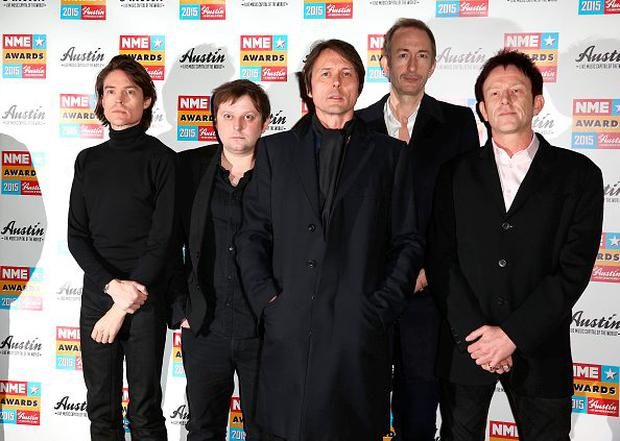 LONDON, ENGLAND - FEBRUARY 18: Brett Anderson (C) and the other member of Suede attend the NME Awards at Brixton Academy on February 18, 2015 in London, England. (Photo by Tim P. Whitby/Getty Images)