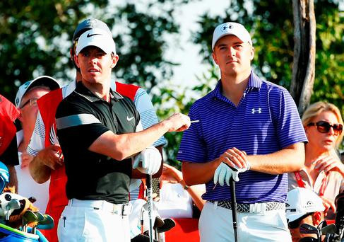 Rory McIlroy of Northern Ireland and Jordan Spieth of the United States look on from the 8th tee during the second round of the Abu Dhabi HSBC Golf Championship at the Abu Dhabi Golf Club