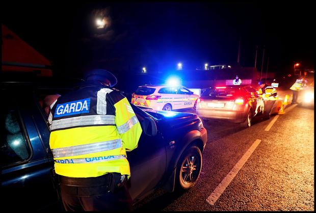 Gardai carry out roadside checkpoints at Ardclough close to where the torso of Kenneth O'Brien was discovered