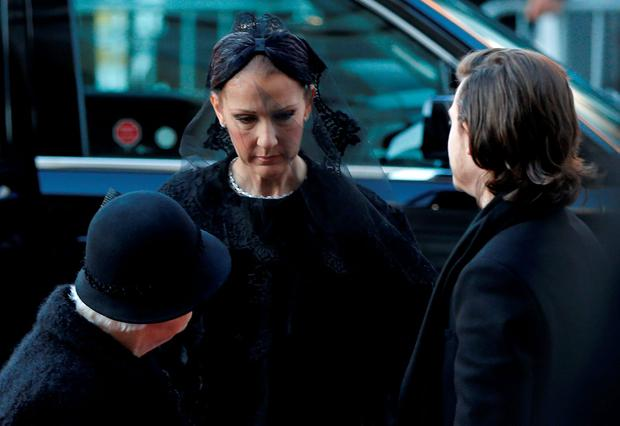 Celine Dion (C) arrives with her son Rene-Charles and mother Therese for the funeral of her husband Rene Angelil at Notre Dame Basilica in Montreal January 22, 2016