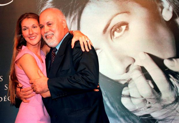 Celine Dion with her husband and manager Rene Angelil, following a press conference at the Molson Centre in Montreal, in this September 8, 1999 file photo