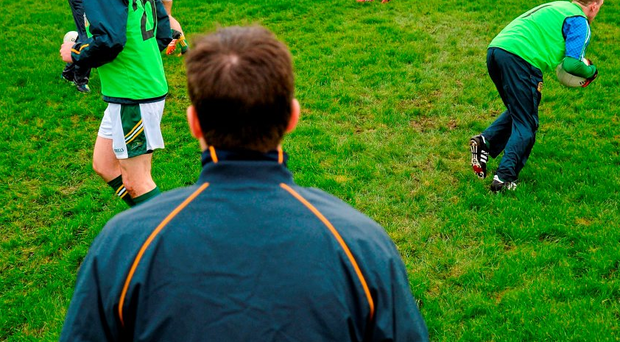 Mick O'Dowd watches his Meath team warm up ahead of their O'Byrne Cup clash against Louth Photo: Sam Barnes / SPORTSFILE
