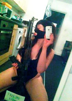 Undated handout photo issued by the Metropolitan Police of Caitlin Adams, 25, posing with an AK-47, who has been jailed for 10 years at Harrow Crown Court after she and five men including a Polish former soldier, were involved in what detectives said was a plot to make and sell illegal guns and ammunition to criminals in London