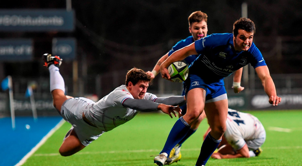 Cian Kelleher, Leinster, is tackled by Will Goodwin Photo:Sportsfile