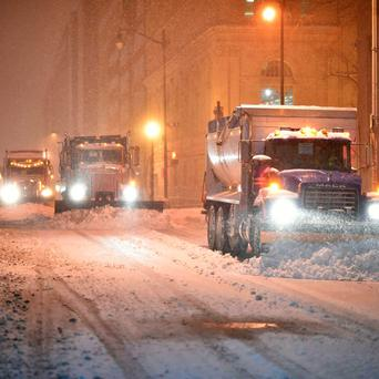 Snow plows clean the snow from a street during a snowstorm in downtown Washington. AFP PHOTO / Mladen ANTONOVMLADEN ANTONOV/AFP/Getty Images
