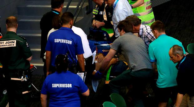 Nigel Sears, coach of Serbia's Ana Ivanovic, is carried away on a stretcher after he collapsed during Ivanovic's third round match against Madison Keys
