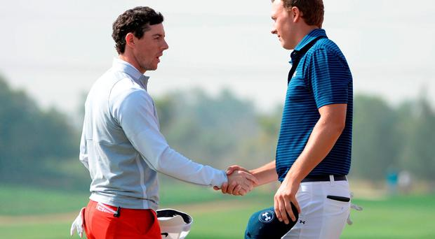 Rory McIlroy of Ireland shakes hands with world number one Jordan Spieth of the United States on the 18th green after completing the round two of the Abu Dhabi Golf Championship