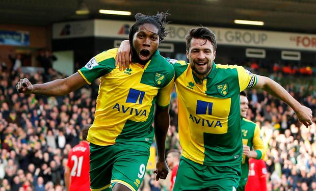 Dieumerci Mbokani celebrates with Russell Martin after scoring the first goal for Norwich Action Images via Reuters / John Sibley