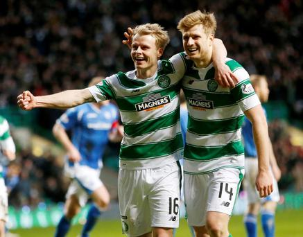 Celtic's Gary Mackay-Steven (left) celebrates scoring his sides third goal with team mate Stuart Armstrong