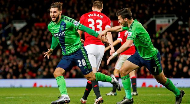 Charlie Austin celebrates with Shane Long after scoring the first goal for Southampton