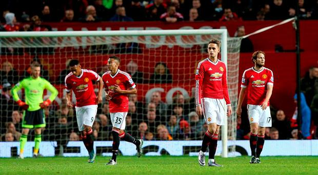 Manchester United players stand dejected after their loss to Southampton at Old Trafford