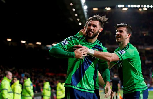 Charlie Austin celebrates with Republic of Ireland striker Shane Long (r) after scoring his first goal for Southampton on his debut at Old Trafford. Photo: Reuters