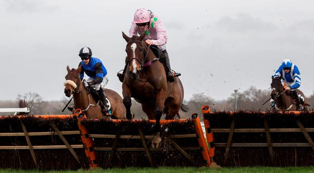 Un De Sceaux, ridden by Ruby Walsh, clears an early fence before going on to win The Sodexo Clarence House Steeple Chase Race at Ascot Photo:PA