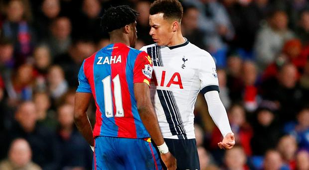 Dele Alli clashes with Wilfried Zaha. Photo: Reuters