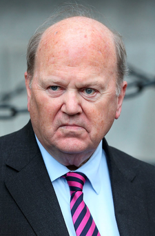 Why the long face: If Michael Noonan believes his own spin then there's little for the finance minister or his government colleagues to worry about Photo Steve Humphreys