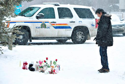 A resident of La Loche, Saskatchewan, pays his respects to the victims of Friday's school shooting Photo: Jason Franson/The Canadian Press via AP
