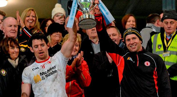 Tyrone joint captains Mattie Donnelly and Sean Cavanagh celebrate with the Dr McKenna cup.