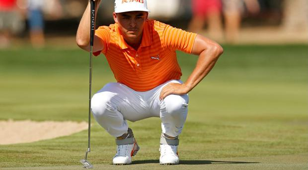 Rickie Fowler lines up his birdie putt at the 2nd hole during the final round
