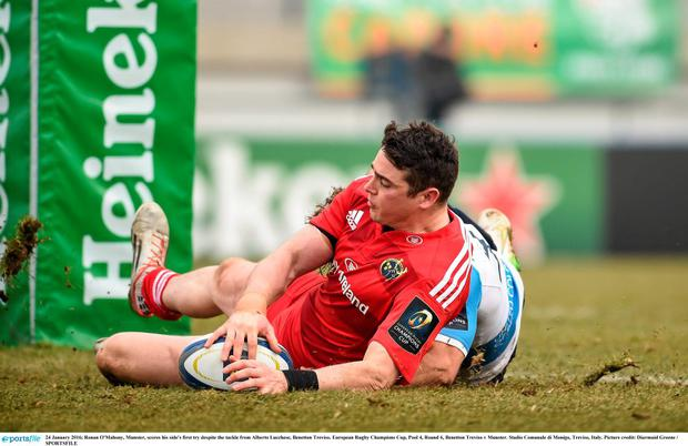 Munster's Ronan O'Mahony scores his side's first try despite the tackle from Alberto Lucchese