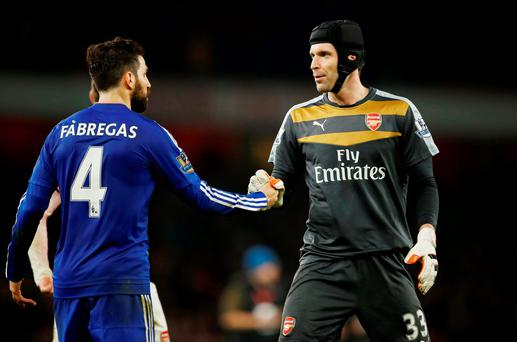 Chelsea's Cesc Fabregas with Arsenal's Petr Cech at the end of the match