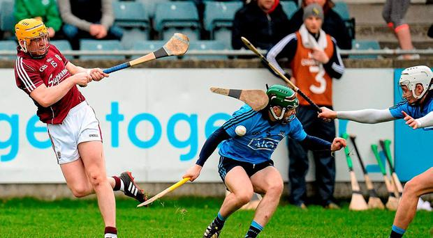 Dublin's Ben Quinn breaks a hurley blocking a shot from Galway's Davy Glennon in their Walsh Cup clash. Photo: Seb Daly / SPORTSFILE