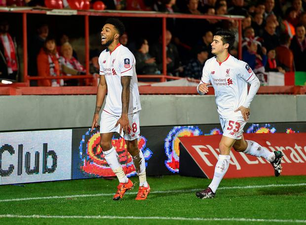 Jerome Sinclair of Liverpool clebrates after scoring an equalising goal during the Emirates FA Cup third round match between Exeter City and Liverpool at St James Park on January 8, 2016 in Exeter, England. (Photo by John Powell/Liverpool FC via Getty Images)