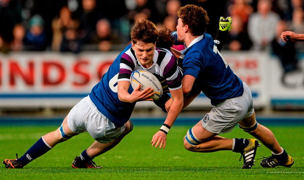 Terenure College's Sam Dardis is tackled by St Mary's Andrew McDermott, left, and Faolán Crowe in Donnybrook yesterday Photo: Dáire Brennan / SPORTSFILE